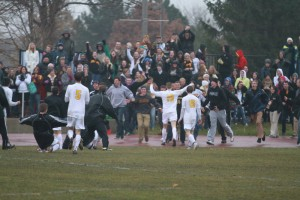 Gustie fans rush the field in celebration after Roth's overtime game-winner.