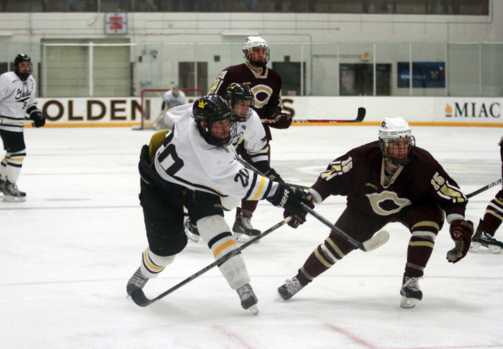 Nate Paulsen rips a slap shot in Saturday afternoon's 3-1 victory over Concordia.  Paulsen provided the assist on Gustavus's second goal of the game.