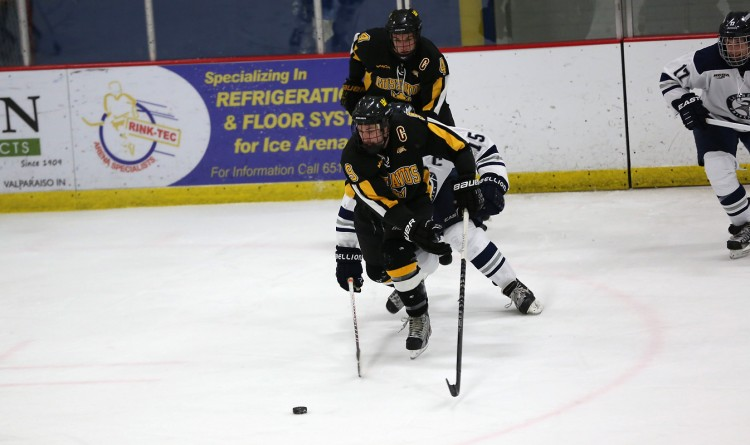 Corey Leivermann's third period goal put Gustavus up 6-5 and capped off a five-goal scoring-spree. Photo courtesy of Larry Radloff, d3photography.com.