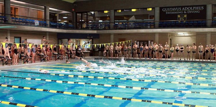 "The Gustavus swimming and diving teams took part in the eighth annual Ted Mullin ""Hour of Power"" on Tuesday night in the Vic Gustafson Pool."