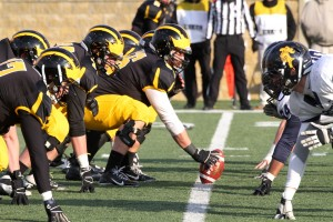 The Gustavus offensive line opened holes for running back Jeffrey Dubose all afternoon in his record-breaking performance.