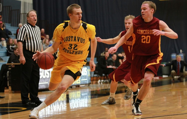Martin Feddersen drives by Concordia defender Brett Bergeson in Saturday's 78-64 win.