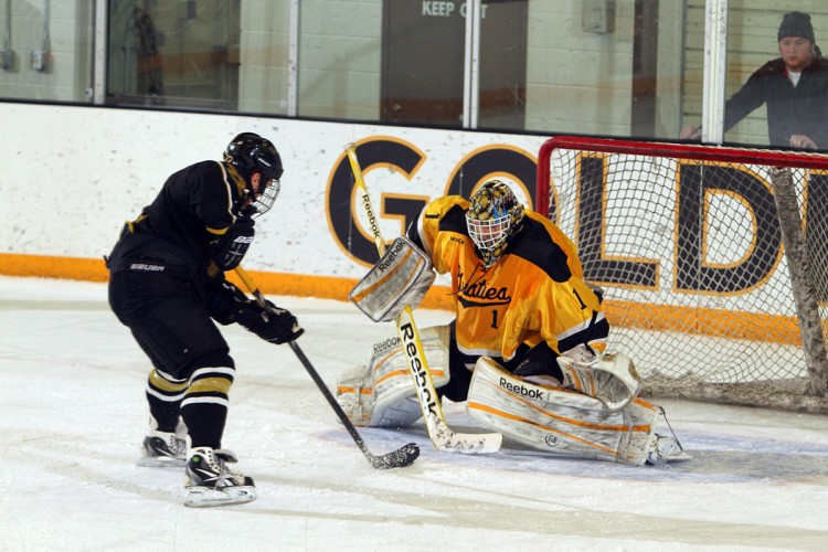John McLean stopped all three of St. Olaf's shootout tries to help the Gusties pick up an extra point over St. Olaf on Saturday night. Photo courtesy of Sara Sneer - Sport PiX.