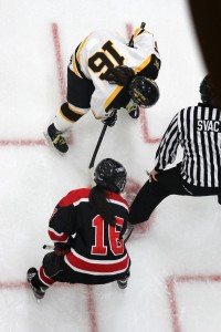 Gustavus's Riley Viner and UW-River Falls's Kait Mason face off in the third period.