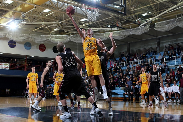Brody Ziegler goes up for a layup in Gustavus's 73-58 loss to UW-La Crosse on Tuesday night in St. Peter.  Photo courtesy of AJ Dahm - Sport PiX.
