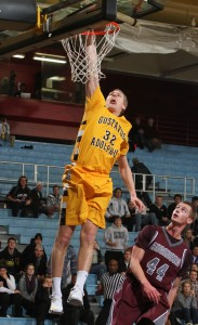 Martin Feddersen throws down a dunk following one of his five steals. (Photo courtesy of Laura Westphal - Sport Pix)
