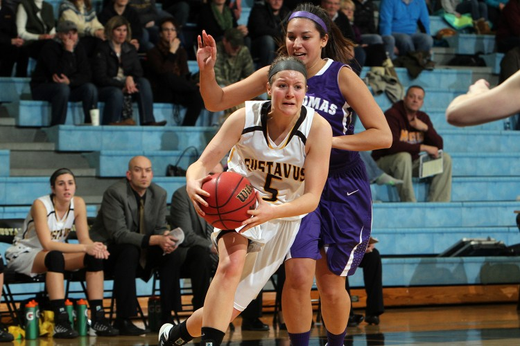 Julia Dysthe drives on a St. Thomas defender in Wednesday night's 79-52 loss. Photo courtesy of A.J. Dahm- Sport PiX