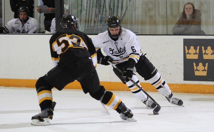 Tyler Lapic makes a move on Adrian defenseman Jake Flegel in Saturday night's 2-0 loss.