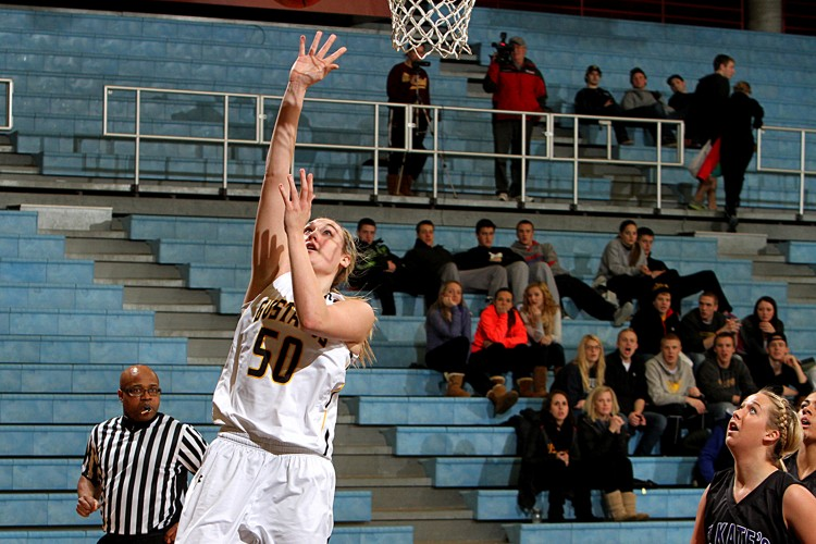 Karina Schroeder goes up for a layup in Monday night's win over St. Kate's. Photo courtesy of Laura Westphal - Sport PiX.