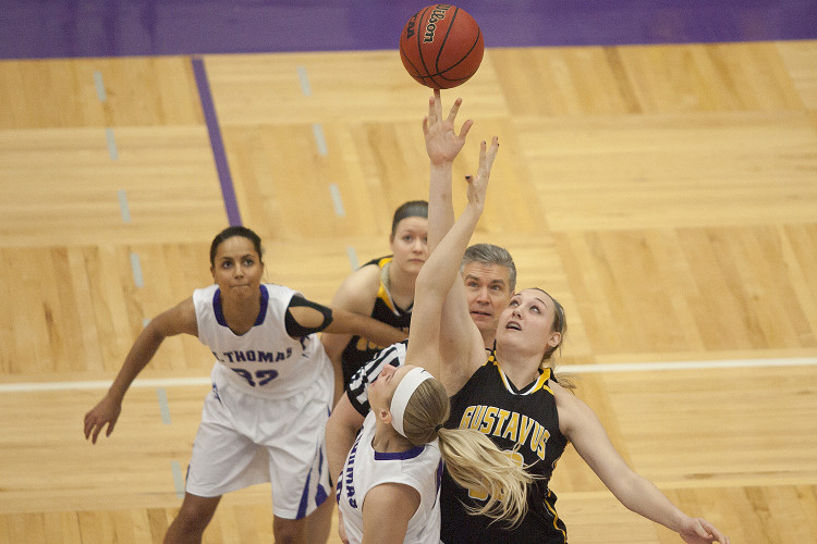 Karina Schroeder reaches up for the opening tip against St. Thomas on Tuesday night.  Photo courtesy of Caleb Williams, d3photography.com.