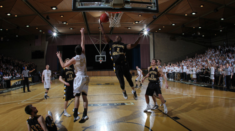 Sophomore Gary Cooper skies high for a rebound in Friday night's loss (Photo courtesy of St. Olaf Sports Information)