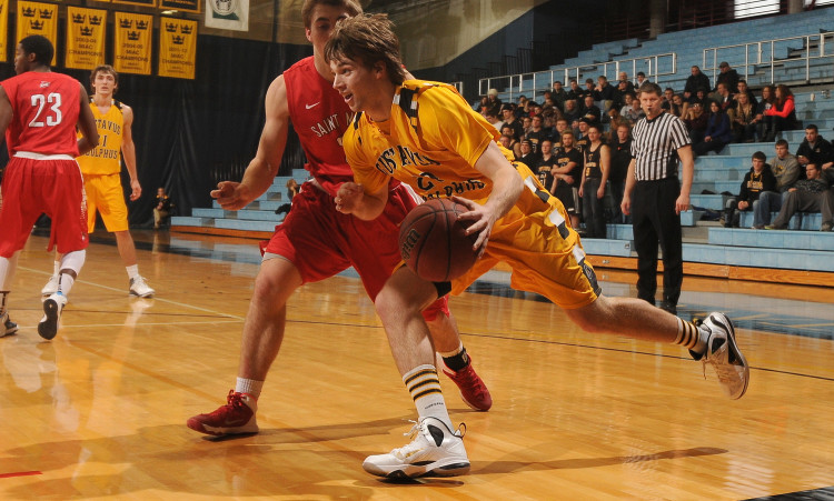 Coleman Sweeney drives past a Saint Mary's defender in Saturday's win. (Photo courtesy of Bridget Larson - Sport Pix)