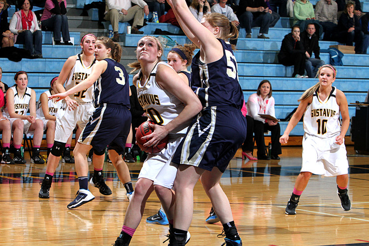 Karina Schroeder makes a move on Bethel's Rachel Parupsky in Wednesday night's 66-60 loss. Photo courtesy of Laura Westphal - Sport PiX.