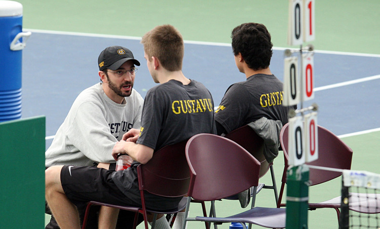 Head Coach Tommy Valentini talks with doubles partners Joey MacGibbon and Luan Luis Chu during Saturday morning's match against Grinnell. Photo courtesy of AJ Dahm - Sport PiX.