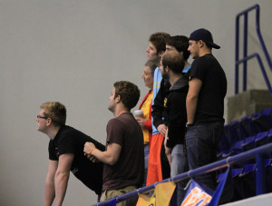 Gustavus fans look to the scoreboard in anticipation of the 400-free relay final results.