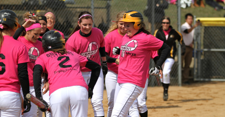 Shelby Nosan is greeted by her teammates after hitting a two-run home run in game one.  Nosan was 6 for 7 on the day.