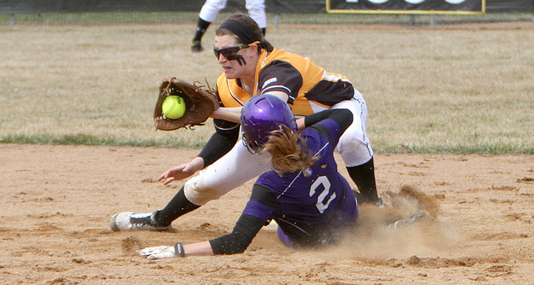 Shortstop Shelby Nosan attempts to catch a Tommie stealing. (Photo courtesy of Morgan Stock - Sport Pix)