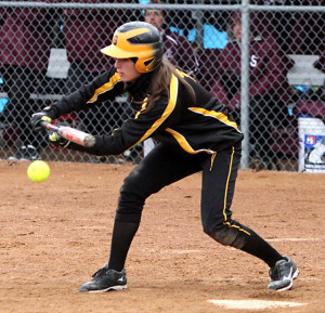 Senior Brittany Brenke squares to bunt. (Photo courtesy of Laura Westphal - Sport Pix)
