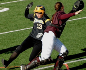 Caitlin Whitney slides into home safely (Photo courtesy of Jim Cella - Concordia Sports Information)