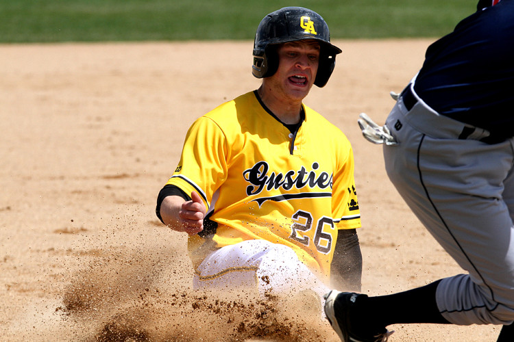 Garrett Fuchs slides into third base on Saturday against Saint John's. Photo courtesy of Laura Westphal - Sport PiX.