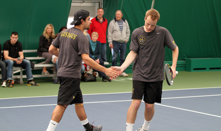 Andres Saenz Hoyo and Marcel Gyswyt celebrate after winning a point on Friday against Saint John's in the MIAC Playoff Seminfals.  Gustavus won the match 9-0.