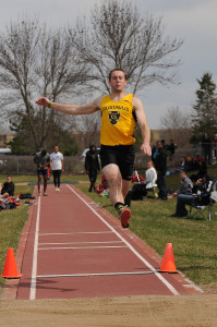 Cameron Clause leaps into the long jump pit.