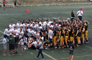 The Lagartos and Gusties pose for a group picture following Caribbean Bowl II.