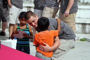 Michael Hintze offers a hug to one of the orphans at Desarrollo Integral Familiar.