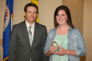 Softball player Kat Dahl accepts the Evelyn Young Award alongside Assistant AD Jared Phillips.