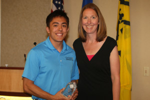 Torey Asao accepts the Community Service Award from Assistant AD Kari Eckheart.