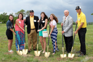 The Drenttel family, Mallory '17, Sandra, Ed, Taylor '12, and Jordan '15 take part in the ceremonial groundbreaking alongside President Jack R. Ohle and Head Coach Scott Moe.