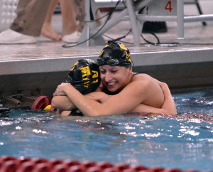 Alissa Tinklenberg hugs her teammate following a race at this year's MIAC Championships.