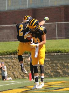 Matt and Gabriel Boyce celebrate following one of Matt's two touchdown catches.