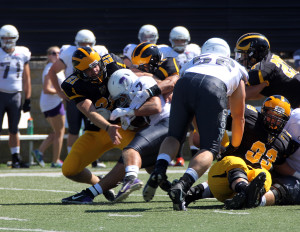 Andrew Lonneman and Zack Martinez bottle up Crown's Josh Edlund in the backfield.