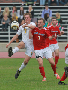 Henry Brose challenges Saint Mary's defender Mike Taber in the air on Wednesday afternoon. Photo courtesy of C.J. Siewert - Sport PiX.