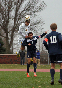 Patrick Leach goes up and over Bethel's Matthew Pisarski  to score his third header goal of the season.