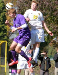 Charlie Adams challenges for a header. Photo courtesy of CJ Siewert - Sport PiX.