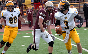 Mitch Hendricks being chased by Derek Rachel.  Photo courtesy of Jim Cell - Concordia Sports Information.