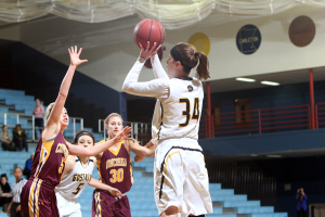 Maddie Ehrich pulls up for a jumper in front of Concordia's Morgan Gunderson.