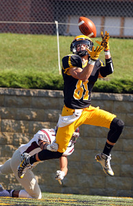 Matt Boyce catches one of his three touchdowns in the win against Augsburg. (photo by AJ Dahm)