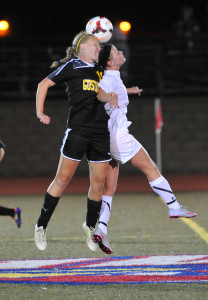 Chaselyn Miller heads a ball over a Saint Mary's player. (photo courtesy of Saint Mary's sports information)