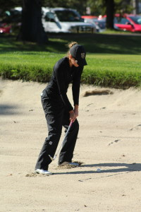 Ellie Brandt hits out of the bunker at the MIAC Championships. (photo courtesy of Matt Higgins, MIAC)