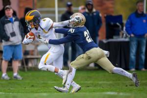 Gabe Boyce stiff-arms a Bethel defender. (photo by Tim Kruse)