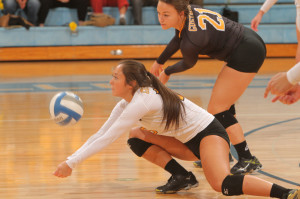 Abby Leitch goes down for a dig against St. Thomas. (photo by AJ Dahm)