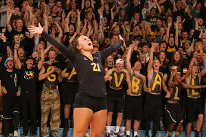 Brittany Luethmers celebrates a point in front of an excited student section. (photo by AJ Dahm)