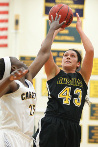 Miranda Rice goes up for a jumper over a Carleton defender in the Gusties' 67-32 victory.