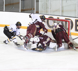 Evan Erickson and Darren Lapic crash the net for a goal. (photo by Chris Coquyt)