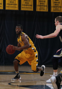 AJ Hatchett drive the lane against Bethel. (photo by Jessica Williams, Gustavus Sports Information)