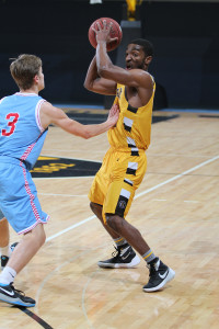 AJ Hatchett looks inside against David Stokman of Saint John's (photo by Chris Coquyt, Gustavus Sports Information)
