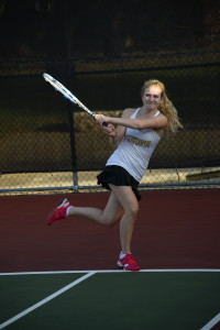 Sheila Sullivan goes for a backhand against East Texas Baptist. (photo courtesy of Blake Dirks)